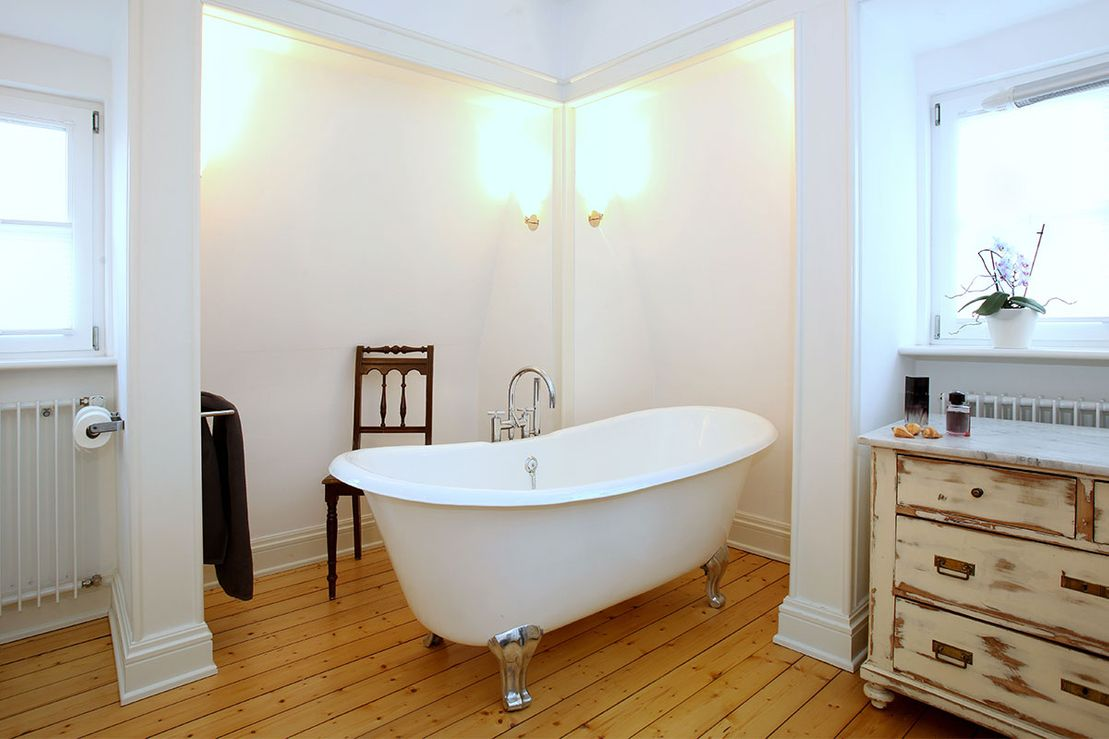 Bathroom with freestanding bathtub